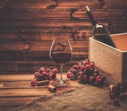 Wine still life in wooden interior Stock Photography
