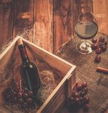 Wine still life in wooden interior Stock Images
