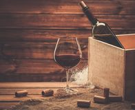 Wine still life in wooden interior Stock Photo