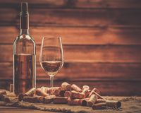 Wine still life in wooden interior Royalty Free Stock Image