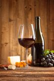 Wine. Still life on wooden keg with vineyard on background Royalty Free Stock Photo
