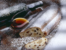 Wine and a stollen with powdered sugar royalty free stock image