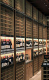 Wine store. Shelves of wine in a modern wine store royalty free stock photography