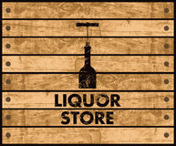 Wine store. Wooden box with a picture of the bottle of wine and liquor store sign Royalty Free Stock Images