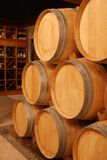 Wine stored in barrels. In a old cellar Royalty Free Stock Photography