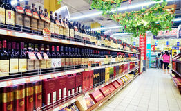 Wine in supermarket retail store shop. Wine on sale on shelf in supermarket retail store shop Royalty Free Stock Photos