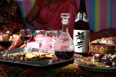 Wine and sweets in the Eastern pavilion Royalty Free Stock Image