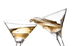 Wine swirling in a goblet martini glass, isolated on a white background. Two wine swirling in a goblet martini glass, isolated on a white background royalty free stock image