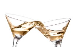 Wine swirling in a goblet martini glass, isolated on a white background. Two wine swirling in a goblet martini glass, isolated on a white background stock images