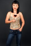Wine Taster. A beautiful Asian woman holding a glass of red wine Royalty Free Stock Image