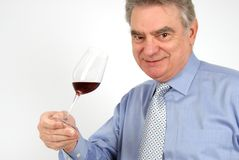 Wine Taster. A wine taster holding a glass of red wine Royalty Free Stock Photo