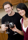 Wine Tasting. A young couple enjoying a glass of wine Royalty Free Stock Photos