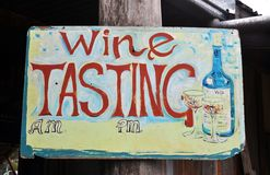 Wine Tasting. Colourful wine tasting notice board with am and pm time slots stock photos