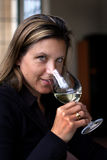 Wine tasting. Pretty woman smelling a glass of wine at a wine-tasting royalty free stock photo