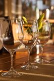 The Wine Tasting. Crystal glasses are ready for a summer wine tasting on the patio of a home royalty free stock photos
