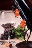 Wine tasting. Arrangement of a glass of wine, a wine bottle and a corkscrew stock image
