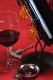 Wine tasting. Arrangement of a glass of wine, a taste-vin, a wine bottle and a vintage corkscrew royalty free stock image