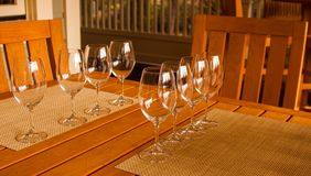 The Wine Tasting. Crystal glasses are ready for a summer wine tasting on the patio of a home Stock Image