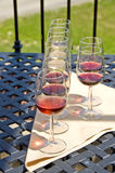 Wine Tasting. Glasses of wines are set up for tasting Stock Image
