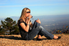 Wine tasting. A young blond woman tasting wine outdoors Stock Photos