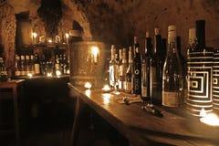 Wine-tasting in cave. Stock Image
