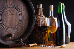 Wine tasting in cellar. With bottles, glass and barrel royalty free stock photo