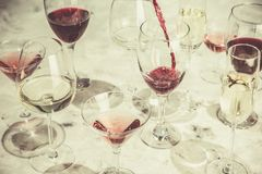 Wine tasting concept - glass with different wine on marble background royalty free stock photography