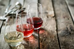 WIne tasting concept - red, rose and white wine in glasses stock images