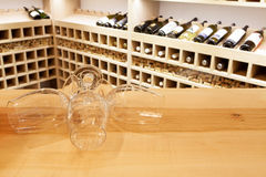 Wine tasting. Empty wine glasses in wine rack royalty free stock images