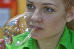 Wine tasting during the festival. Unrecognized woman sommelier tasting wine during the Ukrainian festival Polyana Wino Fest 2013 in in Kiev, Ukraine Royalty Free Stock Image