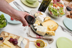 Wine tasting. High angle view of dinner table with cheese and wine Stock Images