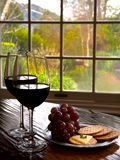 Wine tasting room. Elegant Wine tasting with Red wine and cheese and cracker and beautiful window view stock images