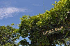 Wine Tasting Room Sign. With Blue Sky royalty free stock photos