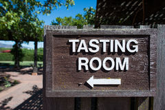 Wine Tasting Room Sign. Directional sign pointing to wine tasting room in Napa, California Stock Photography
