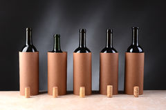Wine Tasting Setup. Five different wine bottles set up for a blind wine tasting. The bottles have the corks removed and setting if front of the disguised bottles royalty free stock images