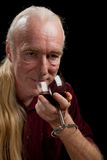 Wine tasting, sideways. A three-quarters portrait of a man tasting wine stock image