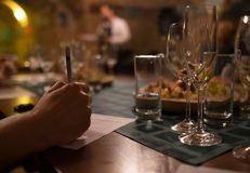 Wine tasting sommelier writes something in note table. Royalty Free Stock Photo