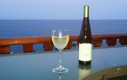 Wine on terrace overlooking the ocean royalty free stock photos