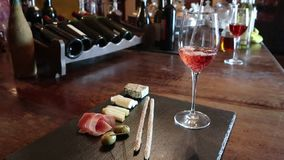 Wine test, crystal glass, red wine, cheese, bar counter background. Glasses of wine and cheese plate. Wine testing. Wine test, crystal glass, red wine, cheese stock video footage