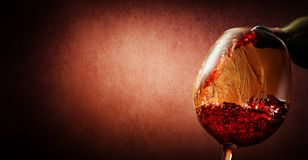 Wine on textured background Stock Images
