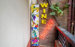Wine therapy sign with brick wall on background royalty free stock photos