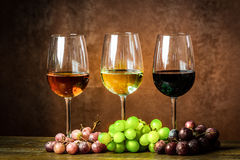 Wine. Three types of wine and grapes royalty free stock photo