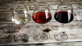 Wine. Three types of wine on a wooden table stock photo