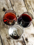 Wine. Three types of wine on a wooden table royalty free stock images