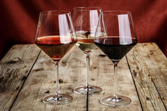 Wine. Three types of wine on a wooden table royalty free stock photos
