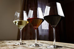 Wine. Three types of wine on a wooden table royalty free stock image