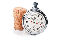 Wine time. Stopwatch and wine cork isolated on a white background stock image