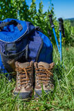 Wine Tourism-Pair of hiking shoes in the grass surrounded vineya Stock Photos