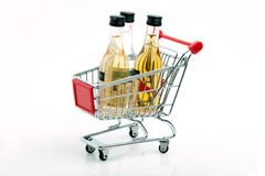 Wine trolley. Trolley with wine botles on a white background Stock Image