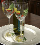 Wine for Two. Two Autumn decorated wine glasses ready for chardonnay Royalty Free Stock Photos